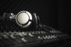 Headphones or Earphone on sound music mixer at home studio recording. Accessories idea for DJ or musician night club background.Black and white.Low key tone Stock Photo