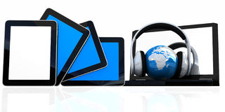 Headphones and  earth on the  laptop and  phones Stock Photos
