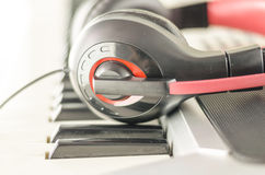 Headphones on electric piano keyboard Royalty Free Stock Photo