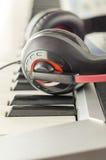 Headphones on electric piano keyboard Stock Image
