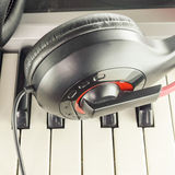 Headphones on electric piano keyboard Stock Photo