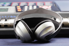 Headphones on electronic piano Royalty Free Stock Photo