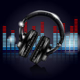 Headphones and equalizer Royalty Free Stock Photo