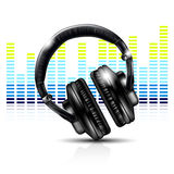 Headphones and equalizer Royalty Free Stock Images
