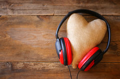 headphones with fabric heart over wooden background Stock Photography