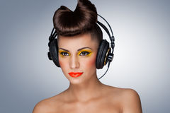 The headphones fashion. A lovely photo of beautiful girl holding headphones in her hand Royalty Free Stock Photos