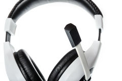 Headphones with focus on microphone side view on white Royalty Free Stock Photography