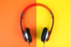 Headphones. Full-size wired headphones on a yellow and orange background Royalty Free Stock Photos
