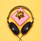 Headphones with gift box - music as gift Royalty Free Stock Images