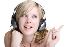 Headphones Girl. Pretty blond girl wearing headphones stock photo