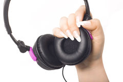 Headphones in a girls hand Royalty Free Stock Photography
