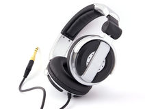 Headphones with gold plug Royalty Free Stock Images