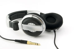 Headphones with gold plug. On white background Stock Photo