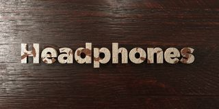 Headphones - grungy wooden headline on Maple  - 3D rendered royalty free stock image Royalty Free Stock Images