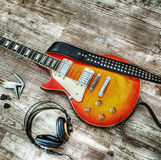 Headphones and guitar in hdr Royalty Free Stock Photography