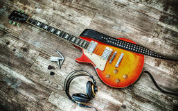 Headphones and guitar in hdr Royalty Free Stock Images