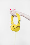 Headphones in the hand.music concept Stock Image