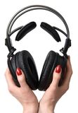 Headphones in hands. Isolated on white royalty free stock photo