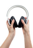 Headphones in hands Royalty Free Stock Photography