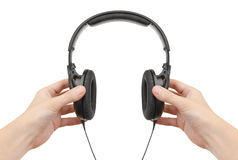 Headphones in hands Royalty Free Stock Photos