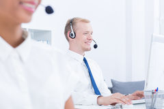 Headphones on heads of telemarketers Royalty Free Stock Photography