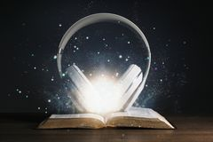 Headphones on the Holy Bible. With glow coming out of the bible royalty free stock photography