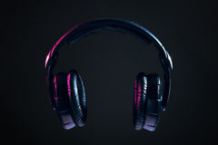 Headphones isolated on black background Stock Image