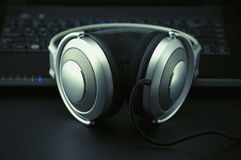 Headphones and keyboard Stock Images