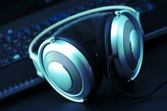 Headphones and keyboard Stock Photos