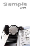 Headphones on keyboard Royalty Free Stock Photos