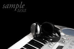 Headphones on keyboard Royalty Free Stock Photo