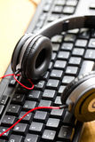 Headphones with keyboard Stock Photo