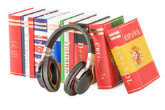 Headphones and language books, learning concept. 3D rendering. Headphones and language books, learning concept. 3D Royalty Free Stock Photography