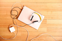 Headphones and a Laptop Stock Images