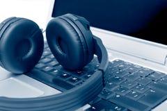 Headphones on Laptop Stock Image