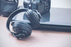 Headphones, laptop and camera Stock Image