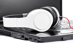 Headphones on a laptop. Close-up shot of headphones on a laptop Royalty Free Stock Image