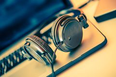 Headphones on Laptop Royalty Free Stock Images