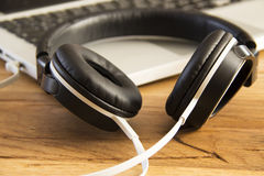 Headphones on a laptop Royalty Free Stock Photos
