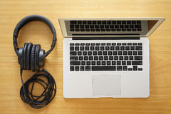 Headphones and laptop for modern working Stock Image