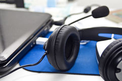 Headphones, laptop and mouse Stock Images