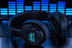 Headphones on laptop. Recording audio Stock Photography