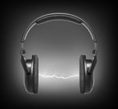 Headphones and lightning Royalty Free Stock Images