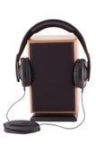 Headphones and  loud speaker. Black headphones and  loud speaker Royalty Free Stock Image