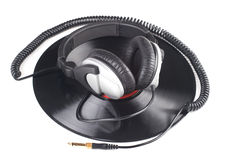 Headphones lying over vinyl record Stock Images