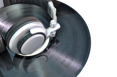 Headphones lying on vinyl with copy space Royalty Free Stock Photos