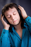 Headphones on man. On black  background Stock Image