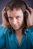 Headphones on man. On black  background Royalty Free Stock Photography