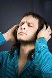 Headphones on man. On black  background Stock Photography