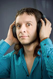 Headphones on man. On black  background Stock Photography